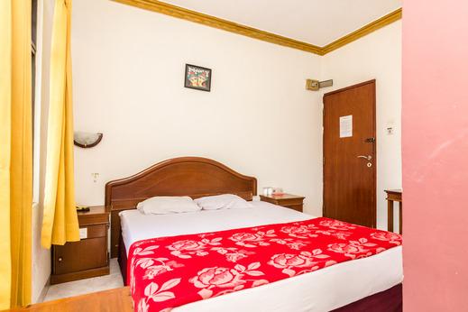 OYO 2422 Rama Hotel Batam - Bedroom