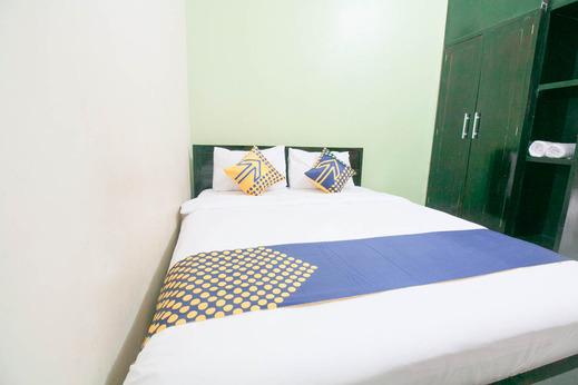 SPOT ON 1968 Grand Azizah Makassar - Bedroom