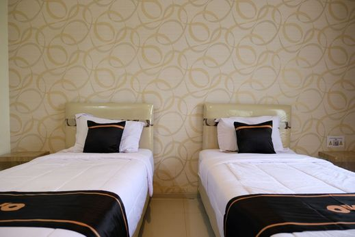 OYO 1616 Hotel Central City 2 Belitung - Bedroom