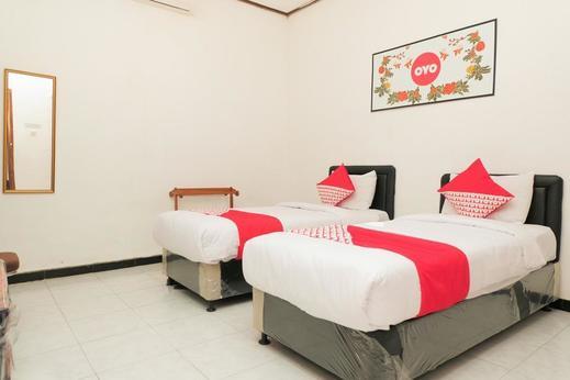 OYO 353 Loesje Guest House Syariah Malang - Bedroom