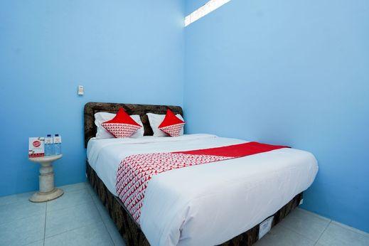 OYO 1316 Mentari Family Homestay Probolinggo - Bedroom