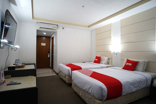 Capital O 1963 Hotel The New Benakutai Balikpapan - Bedroom