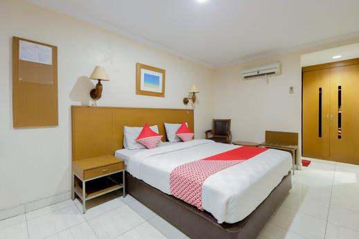 OYO 919 Hotel Kalisma Syariah Near RS Pelni Jakarta - Bedroom