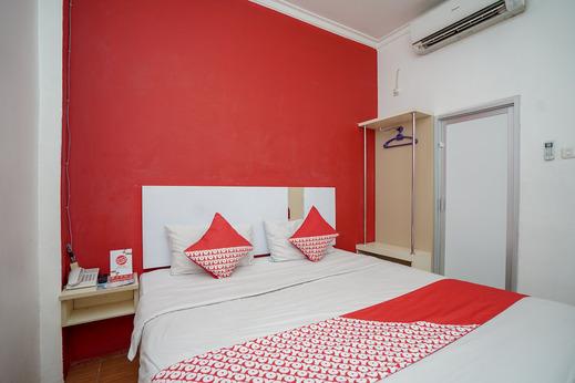 OYO 575 Blessing Hotel Palembang - Bedroom