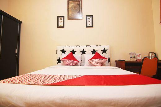 OYO 1566 Griya Inayah Syariah Bandar Lampung - Bedroom