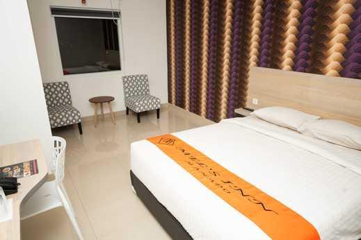 Mel's Inn Manado - tempat Tidur