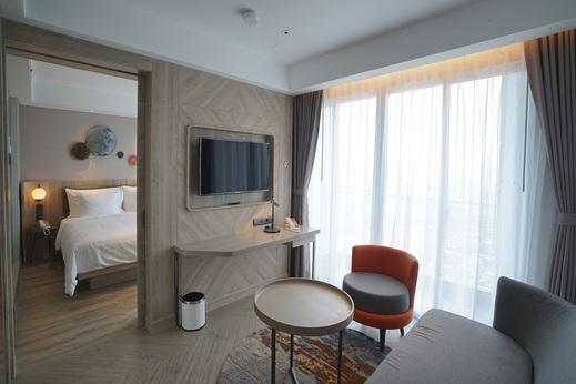HARRIS Suites Puri Mansion Jakarta - 01 Bedroom Suites Living room