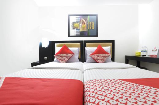 OYO 161 DC Hotel Utan Kayu Jakarta - Bedroom