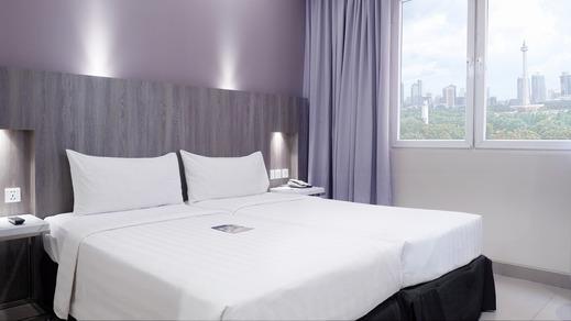 Royal Palm Hotel & Conference Center Cengkareng Jakarta - Kamar Deluxe dua tempat tidur
