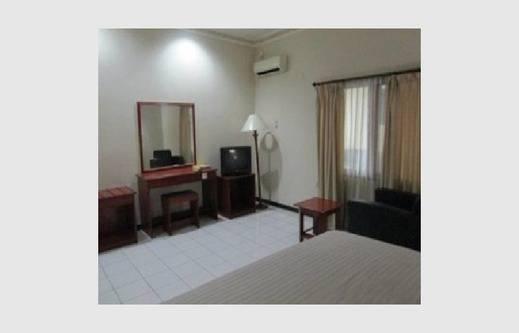 NIDA Rooms Jendral Yani Balikpapan - Kamar tidur