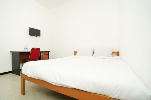 Merapi Inn Syariah by eCommerceLoka Surabaya - Bedroom