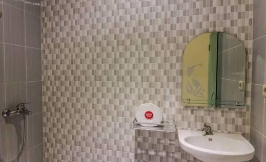 NIDA Rooms Sentral Samudra Pangeran Banjarmasin - Kamar mandi