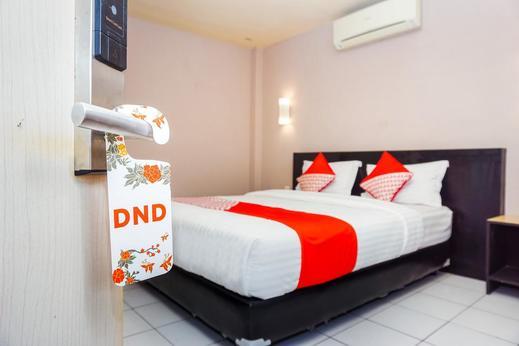 OYO 382 Pagaruyung Tanah Datar - Bedroom