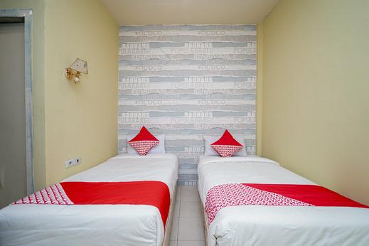OYO 736 Hotel Best Skip Palembang - Bedroom