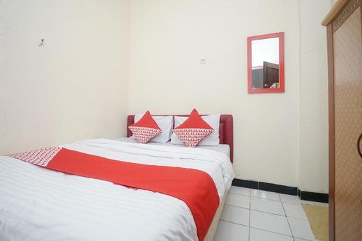 OYO 448 Hotel Central Palembang - Bedroom