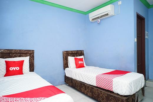 OYO 2343 Winolanto Guest House Syariah Balikpapan - Bedroom