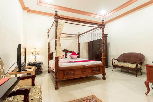 OYO 994 Huber Apartment Medan - Bedroom