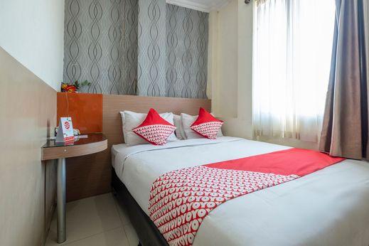 OYO 1560 Capital Hotel Makassar - Bedroom
