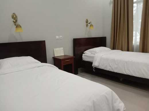 OYO 3277 Inayah Pkpri Hotel Syariah Serang - Bedroom