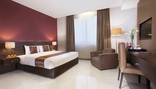 Grage Ramayana Hotel Yogyakarta - kamar executive 1 bed besar