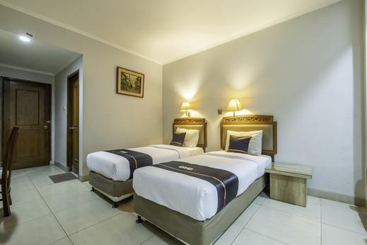 OYO 2329 Hotel Nyland 3 Cijagra Bandung - Bedroom
