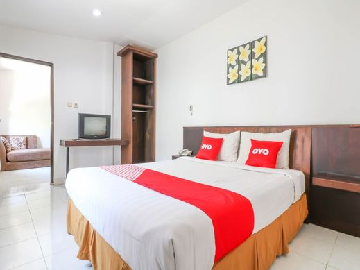 OYO 1666 Grand Pudjawan Hotel Bali - Bedroom Su F