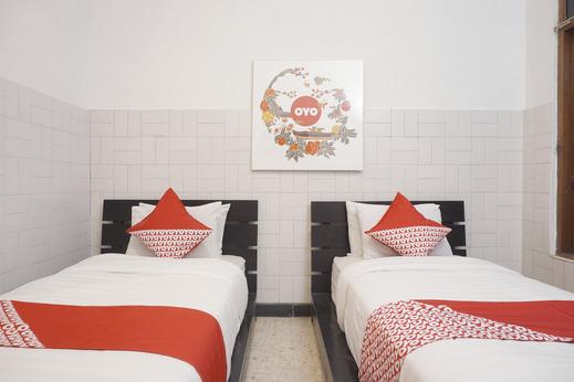 OYO 461 Hotel Madukoro Near RSI Hidayatullah Yogyakarta - Bedroom