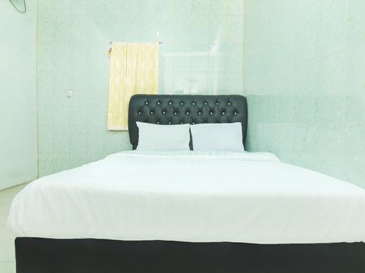 OYO Life 2572 Tachi Stay Guest House Syariah Batam - Bedroom SD