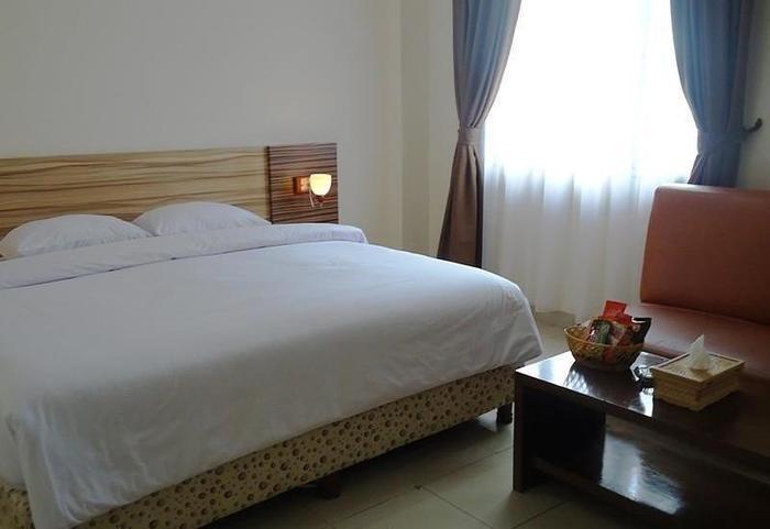 Hotel Cosmo Jambi - Kamar tamu