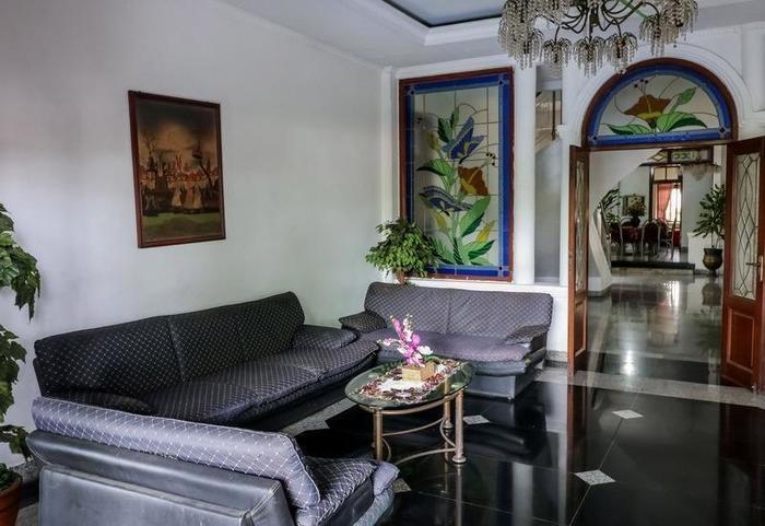 NIDA Rooms Tugu Kujang Bogor - Ruang tamu