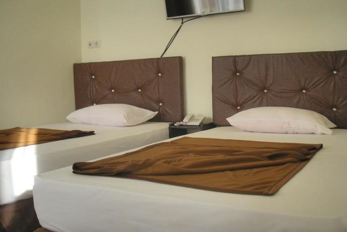 Dena Hotel Kupang - Kamar tamu