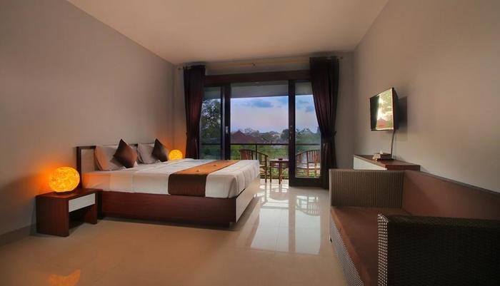 Sri Kandi Inn By Gamma Hospitality Bali - Bedroom