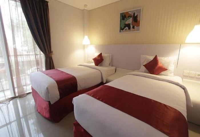 Durian Condotel Suite Makassar - 2 Tempat tidur kecil