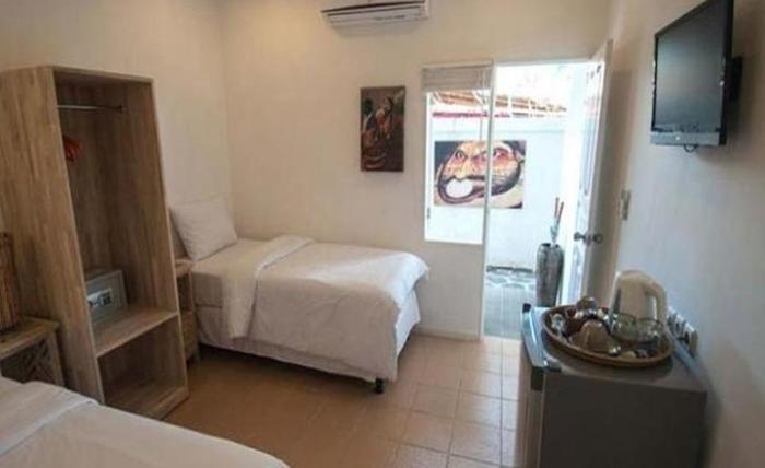 Scallywags Mango Motel Lombok - Kamar tamu