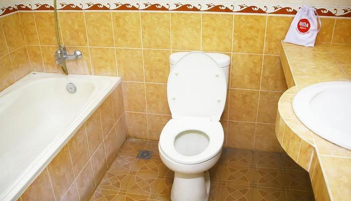 NIDA Rooms Ring Road Utara 1E Jogja - Kamar mandi