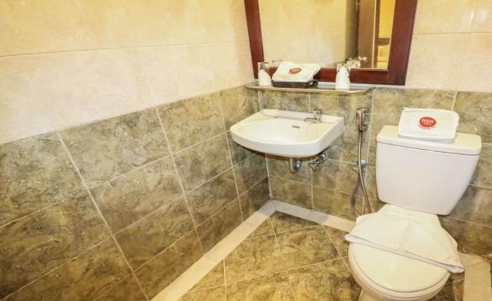 NIDA Rooms Pramuka 55 Sentalu - Kamar mandi