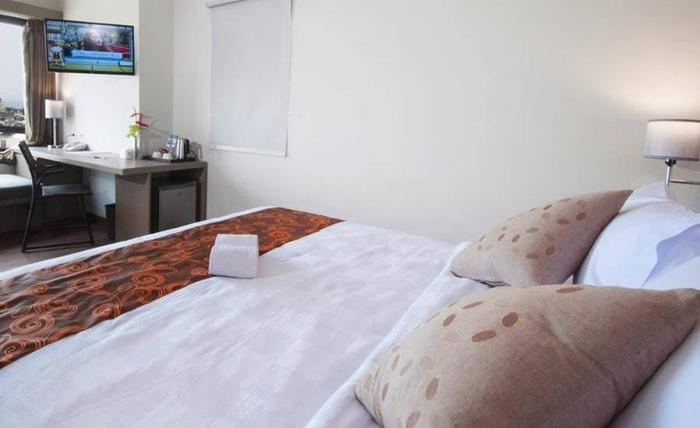 Genio Hotel Manado Manado - Kamar tamu
