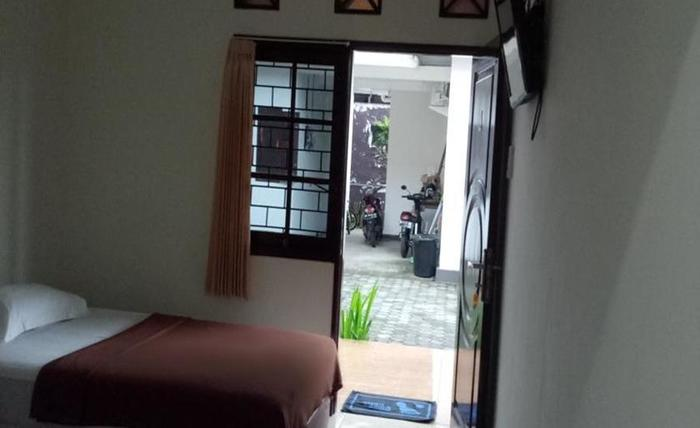 Ninety Nine Guesthouse Lombok - Kamar tamu