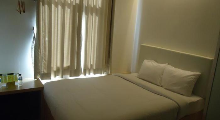 Q Hotel Bali - Kamar Tamu