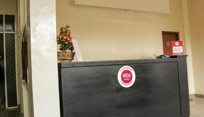 NIDA Rooms Tanah Merah Ancol - Resepsionis