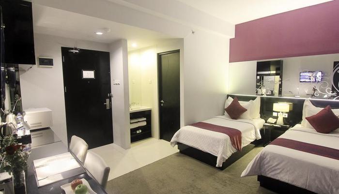 Grand Darmo Suite Surabaya - Deluxe Suite Twin