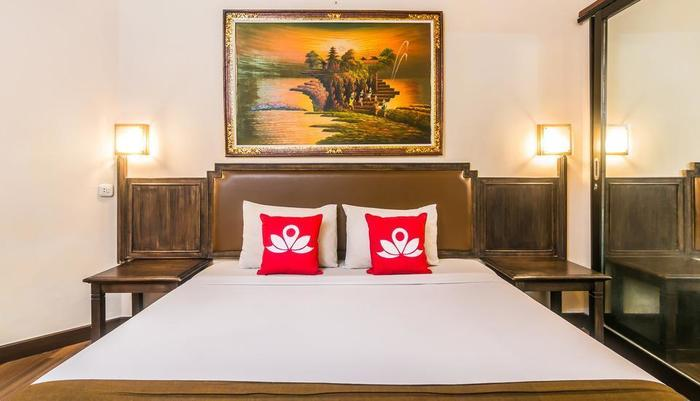 ZenRooms Kuta Flora - Tampak tempat tidur double