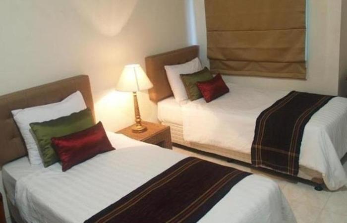 Signature Hotel Mandala Kencana Cianjur - Kamar Deluxe