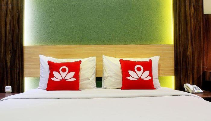 ZenRooms Lengkong Gatot Subroto - Tampak tempat tidur double