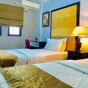 Safirna Transito Hotel Ternate - Deluxe Twin