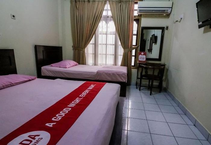 NIDA Rooms Tambusai 145 Pekanbaru Pekanbaru - Kamar tamu