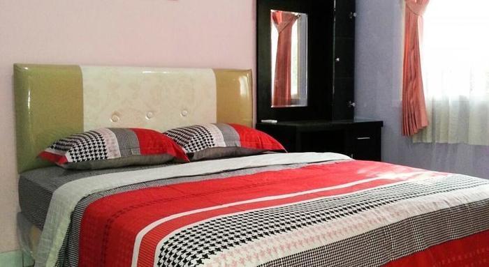 ZenRooms Cendana Mulia Pajajaran - Tampak tempat tidur double