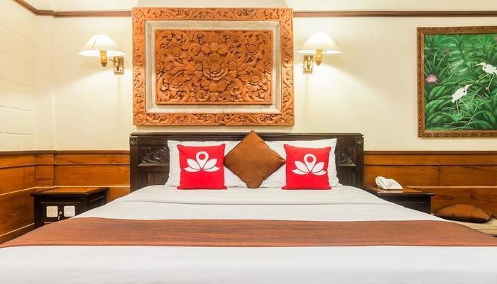 ZenRooms Kuta Dewi Sartika - Tampak tempat tidur double