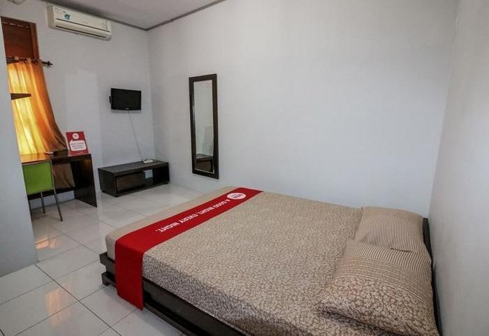 NIDA Rooms Mircan Baru Depok Airport Jogja - Kamar tamu