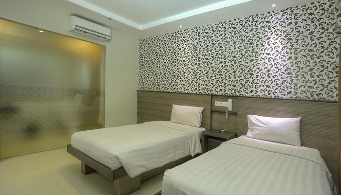 Everyday Smart Hotel Bali - Kamar dengan dua tempat tidur